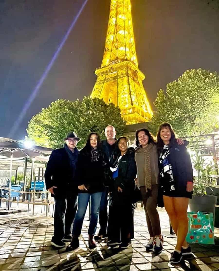 A few friends in front of a Paris landmark